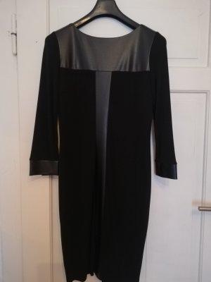 schwarzes Kleid mit Lederdetails