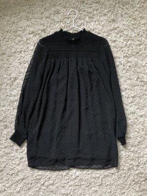 Schwarzes Kleid mit Pünktchenstruktur