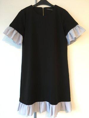 Schwarzes Kleid mit Voilant an Ärmeln und Saum Größe S / M 38