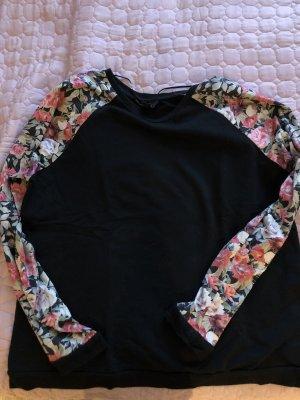 Schwarzes Langarmshirt mit bunten Ärmeln