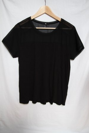 Schwarzes lockeres Shirt mit see-through-Part