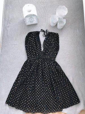 Schwarzes Minikleid mit goldenen Punkten