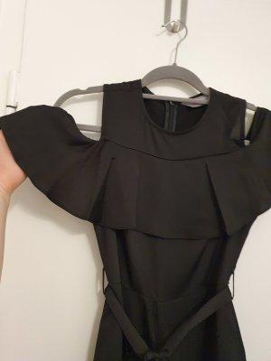 schwarzes overall mit weiten beinen