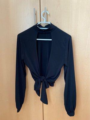 schwarzes rückenfreies Shirt