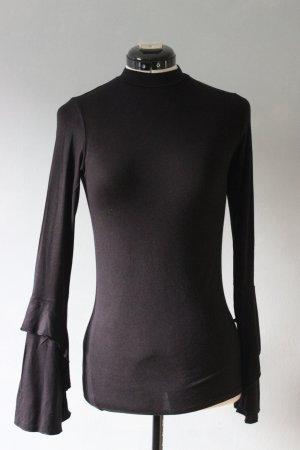 Schwarzes Shirt Armdetail