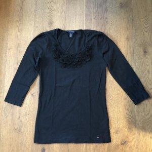 Schwarzes Shirt mit Blütenapplikationen