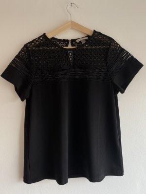 Schwarzes Shirt mit Details