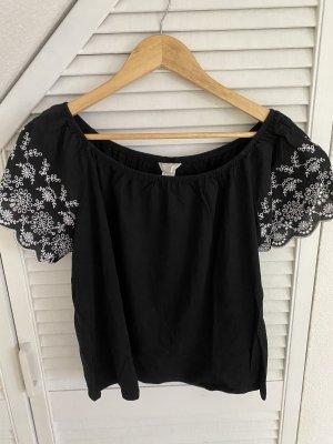 Schwarzes Shirt mit Verzierungen