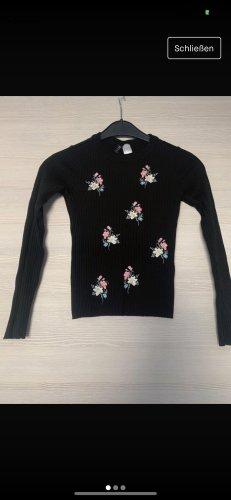 Schwarzes Sweatshirt mit Blumen