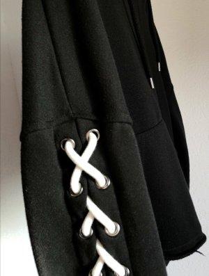 Schwarzes Sweatshirt mit knoten an der Seite