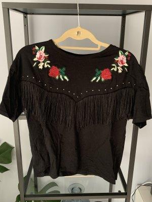 Schwarzes T-Shirt mit Fransen und Blumenmuster