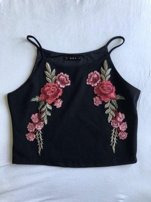 Schwarzes Top mit Blumenmuster