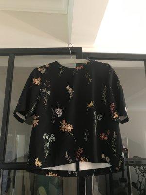 Schwarzes Top von Zara mit schönem Print.
