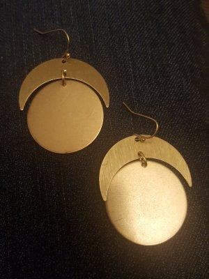 Boucle d'oreille incrustée de pierres doré