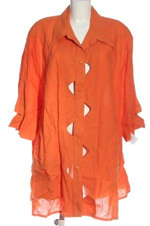 Sempre Piu Blusa de lino naranja claro look casual