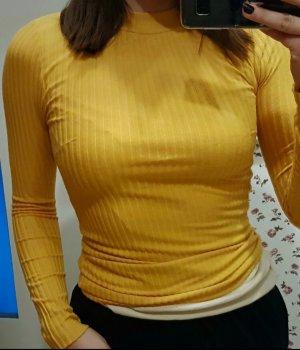 Camisa de cuello de tortuga marrón arena-naranja dorado