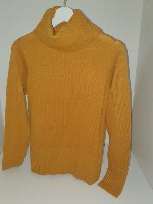 Jersey de lana naranja dorado