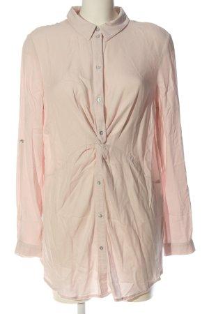 Seraphine Blusa larga rosa look casual