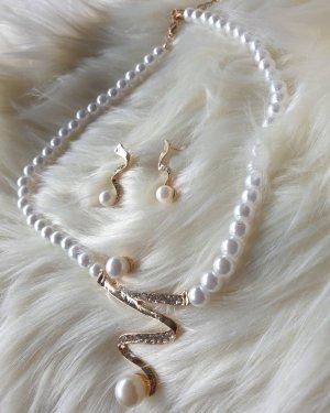 Paraorecchie bianco-oro