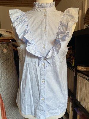 Set Blusa de cuello alto azul claro