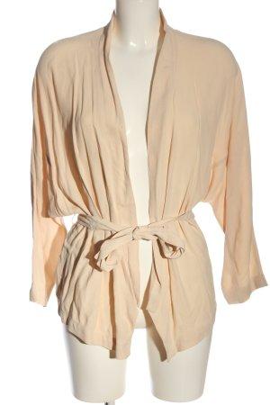 Set Chaqueta tipo blusa crema look casual