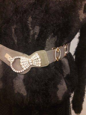 Cinturón pélvico gris-color plata