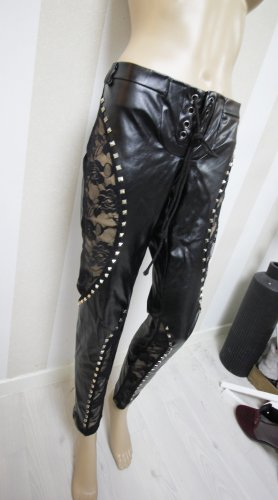 Pantalón de tubo negro-color plata