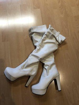 Botas sobre la rodilla blanco