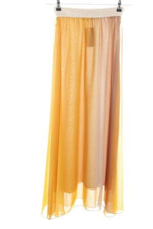 Falda larga naranja claro-nude degradado de color look casual