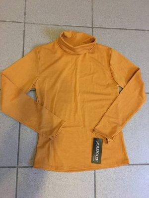 Camisa de cuello de tortuga naranja dorado