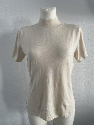 Camisa de cuello de tortuga crema-blanco puro