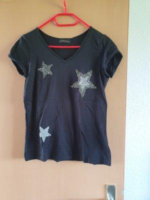 Shirt mit Klitzersternen in schwarz