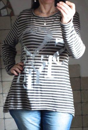Shirt, Tunika, Langarmshirt mit Streifen und Aufdruck / Print in silber, Farbe des Shirts: beige / dunkelbraun, A-Linie, weicher Strick, oben schmal, nach unten weiter, hinten etwas länger, lange Ärmel, sehr weich und angenehm, Rundhals,95% Baumwolle, 5%
