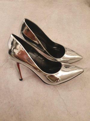 Zapatos de punta color plata
