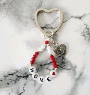 silberfarbener Herz Schlüsselanhänger mit kleinem Herz und HOME Schriftzug