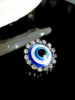Spilla argento-blu neon