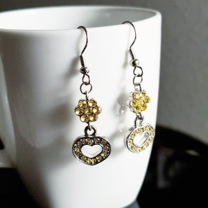 Boucle d'oreille incrustée de pierres argenté-jaune