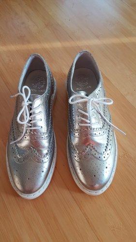 Silberne Schuhe von Poelman