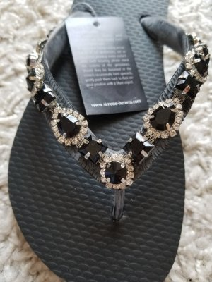 Sandalo toe-post nero-argento