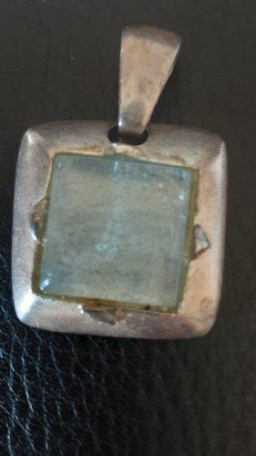 Medallón color plata-azul pálido