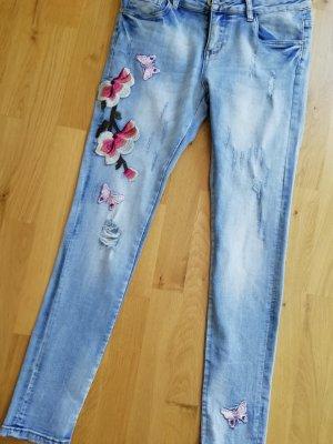 Skinny Jeans Blumenstickerei