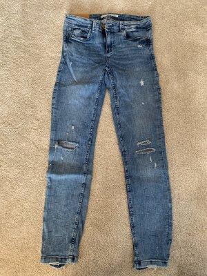 Skinny Jeans mit Löcher