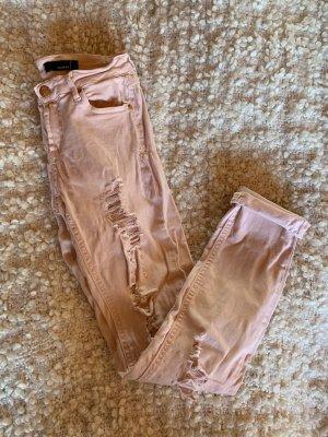 Skinny Jeans mit Rissen rosa
