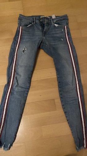 Skinny Jeans mit sportlichen Details