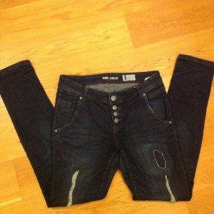 Skinny Jeans mit Stretch im used-style, Gr. 30/32