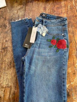 Skinny jeans stickerei blume