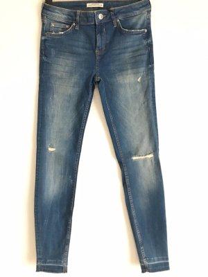 Skinny Jeans zerrissen
