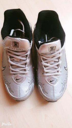 Nike Zapatilla tipo cuña color plata