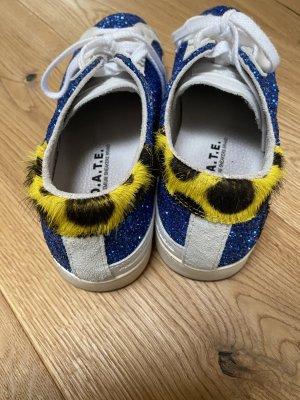 Sneakers mit Fell und Glitter