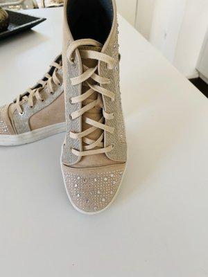 Sneaker stringata rosa pallido